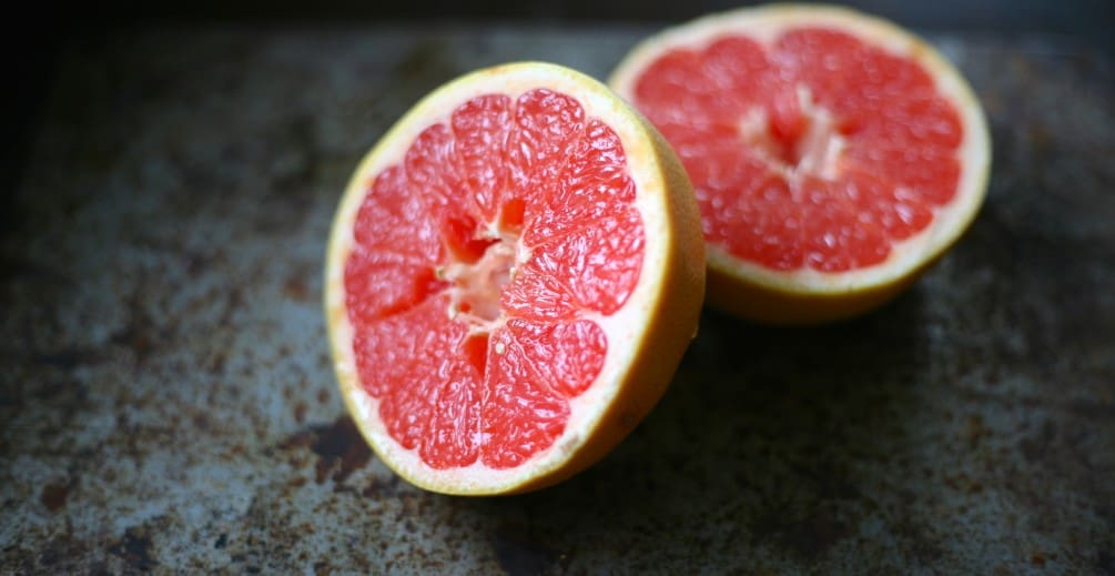pink grapefruit cut in half