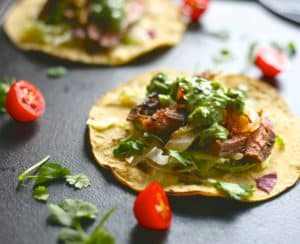 grilled steak taco with herb sauce