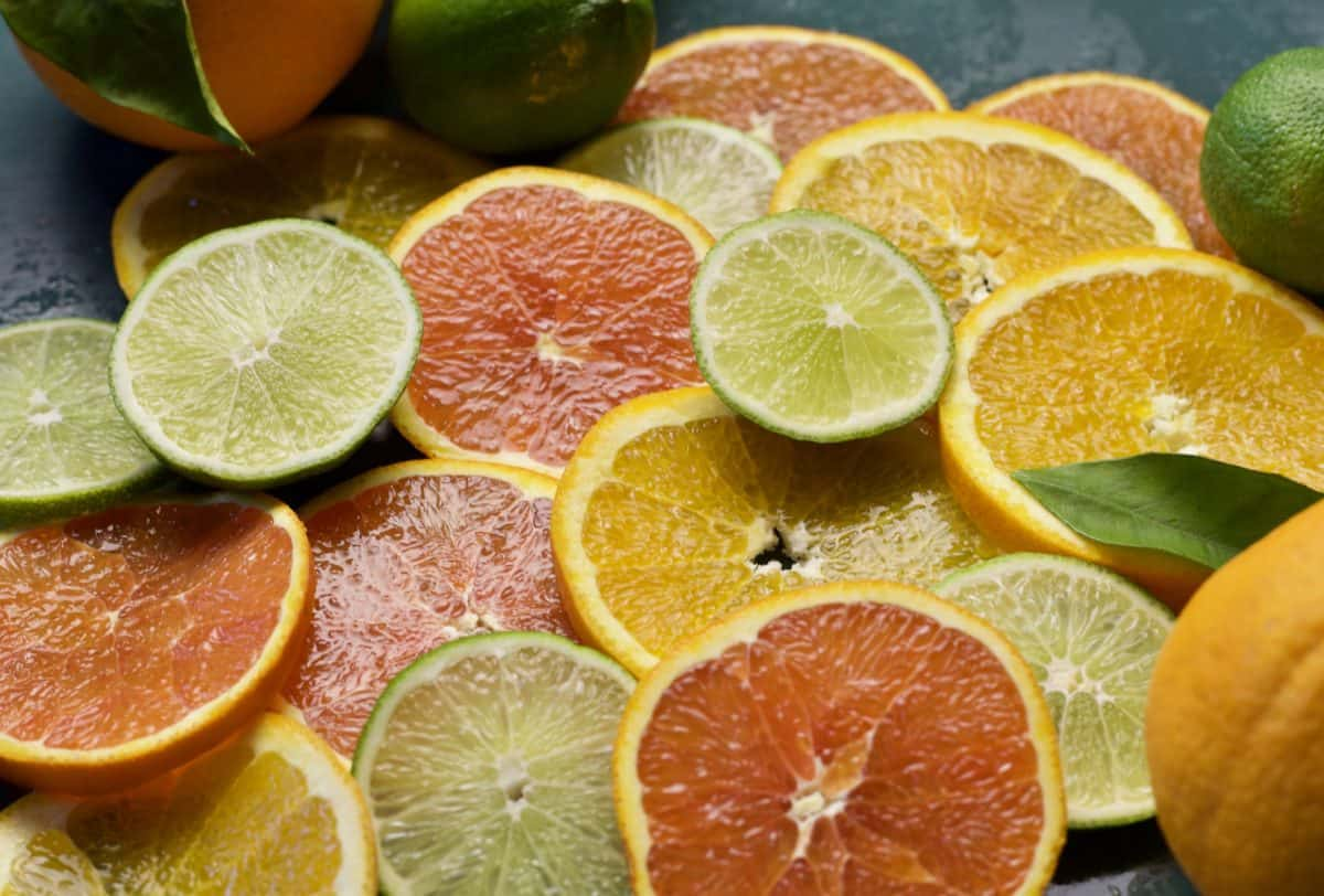 sliced lemons, grapefruit, oranges and limes piled on top of each other