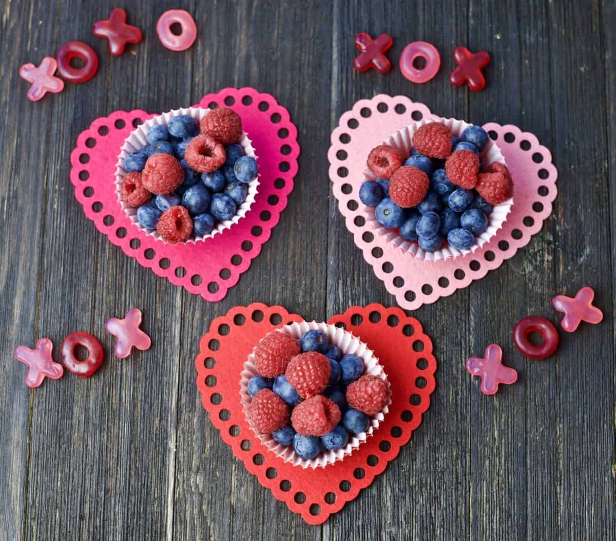 berry bowls with candy xoxo surrounding