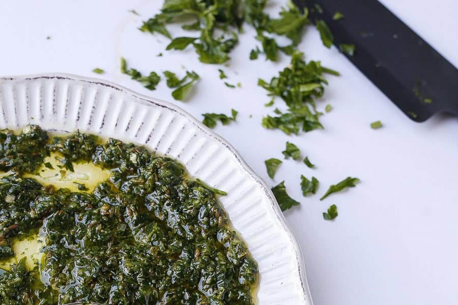 close up of middle eastern chermoula sauce with chopped herbs